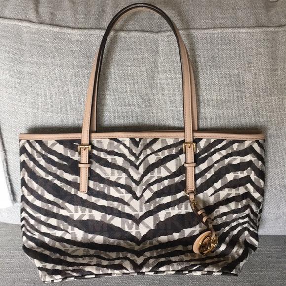 7ff6d2d140e684 Michael Kors Signature Zebra Print Handbag purse. M_5b4baefec9bf50467f8c91c1